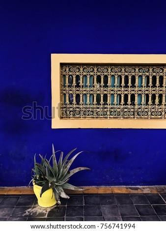 Jardin majorelle blue wall yellow window close up