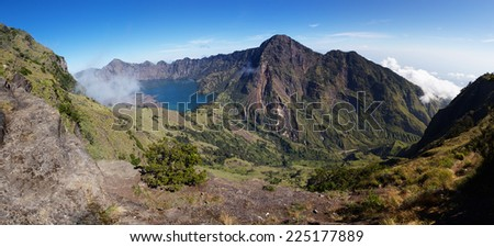 Jari Baru volcano and lake inside Rinjani mountain panorama, Lombok, Indonesia - stock photo