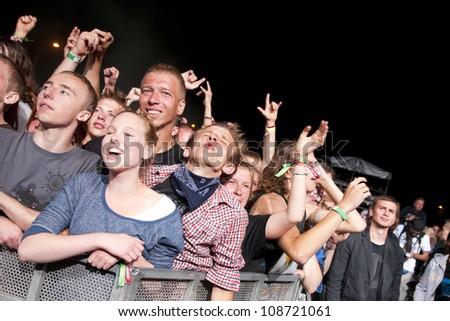 JAROCIN, POLAND - JUNE 22: A crowd of unidentified fans enjoy music at the Jarocin Festival in Poland on June 22, 2012 in Jarocin, Poland - stock photo