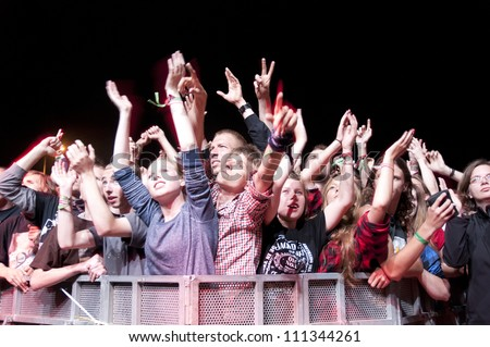 JAROCIN, POLAND - JUNE 22: A crowd of unidentified fans enjoy music at the Jarocin Festival in Poland on June 22, 2012 in Jarocin, Poland