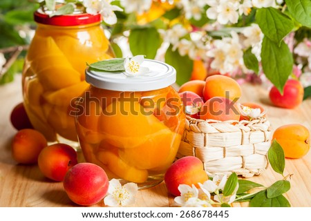 Jars of apricot and peach preserves - stock photo