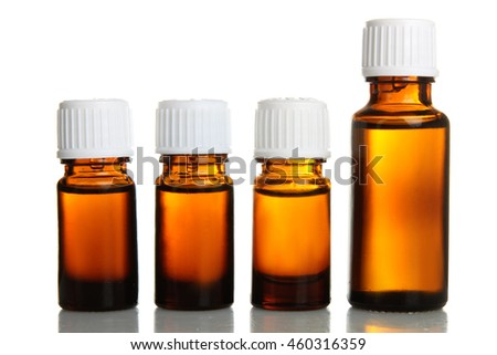 Jars of aromatic oils on isolated background. The concept of aromatherapy