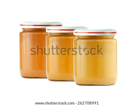 Jars of baby puree isolated on white - stock photo
