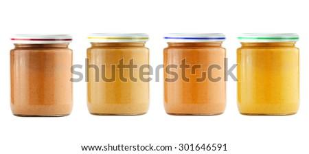 Jars of baby puree isolated on white - stock photo
