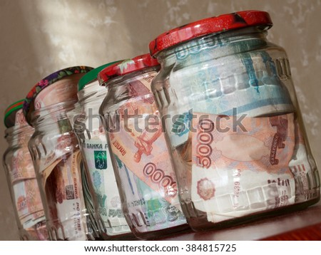 Jars of cash. Glass jars with banknotes