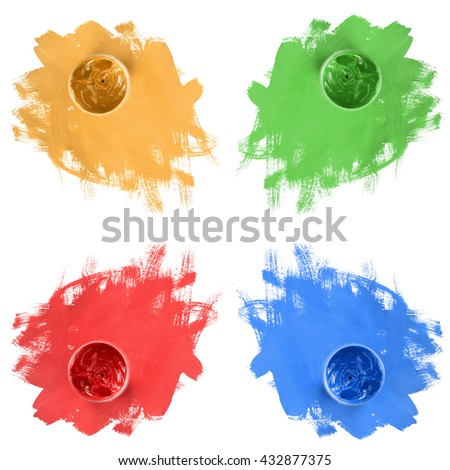 Jars of colorful paint and brush strokes isolated over white