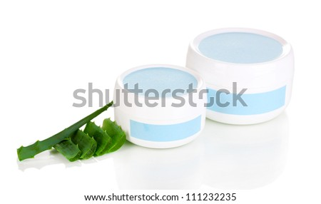 Jars of cream with aloe vera isolated on white - stock photo