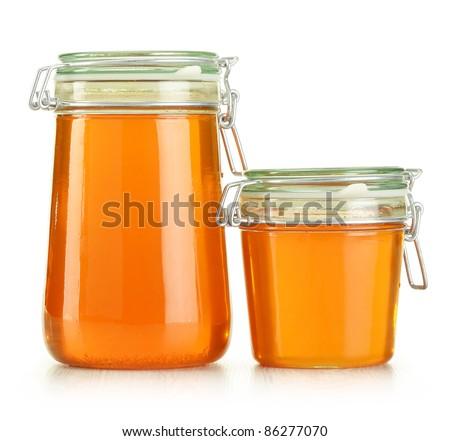 Jars of honey isolated on white - stock photo