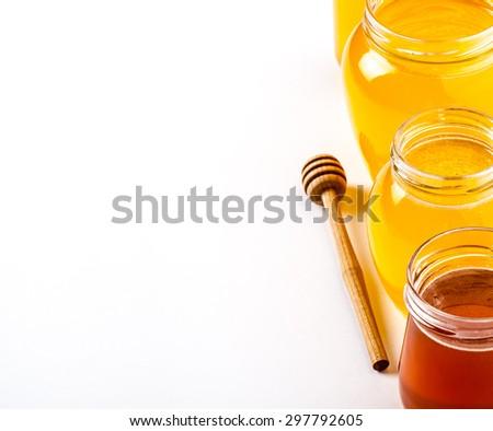 jars of honey on a white background. food, medicine - stock photo
