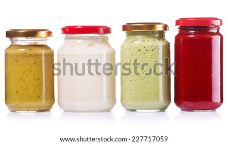 jars of preserved mustard, ketchup, horseradish isolated on white background - stock photo