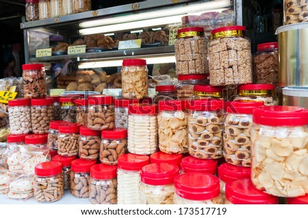 Jars of snacks are stacked outside a shop in the Chinatown district of Kuala Lumpur.