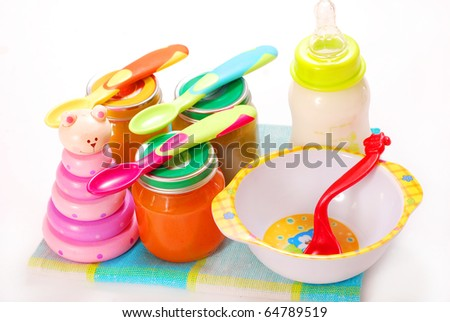 jars of various baby food and bottle of milk - stock photo