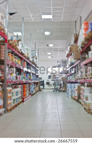 Jars with a paint in a warehouse - stock photo