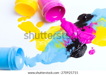 Jars with a paint on a white background - stock photo