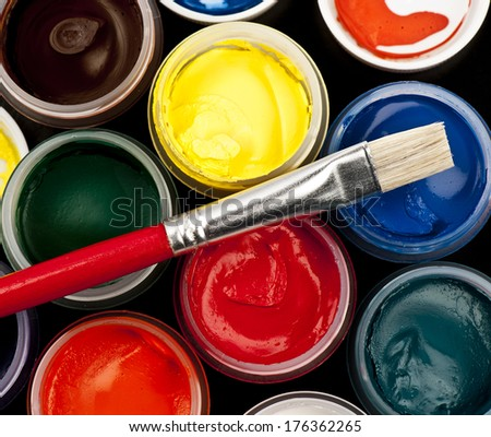 Jars with colored gouache with brush - stock photo