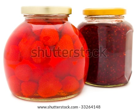 Jars with jam and compote against the white background - stock photo