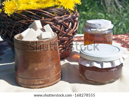 jars with linden honey and flowers