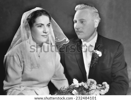 JASLO,POLAND - CIRCA 1962: vintage atelier photo of married couple