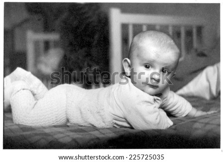 JASLO,POLAND - CIRCA 1950 : vintage photo of baby boy in bed