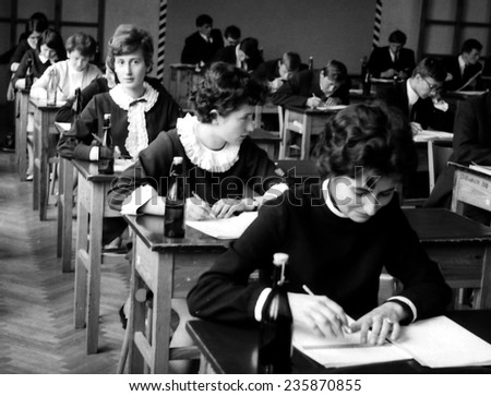 JASLO,POLAND -CIRCA 1968:vintage photo of school-girls writing their exam