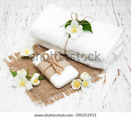 jasmin flowers and soap on a old wooden table