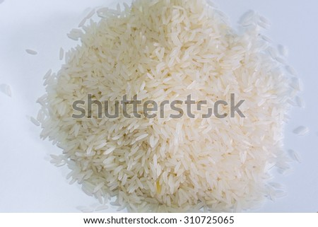 Jasmin rice on a pile on white background - stock photo