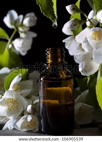 Jasmine essential oil for aromatherapy. - stock photo