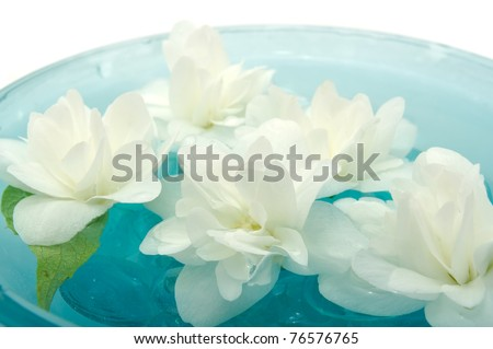 Jasmine Flowers Floating on Water - stock photo