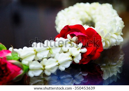 """Jasmine garland Thais have unique ways of arranging flowers and using them in decorations, which are different from other places. Thai garlands called """"Phuang Malai"""" - stock photo"""