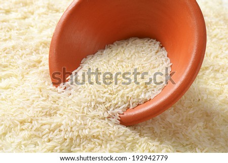 jasmine rice poured out from the bowl - stock photo