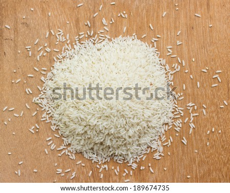 Jasmine Rice rice grian on wood background