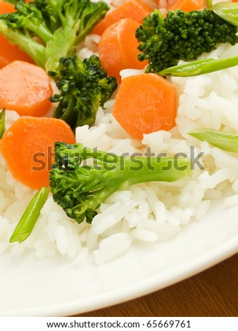 Jasmine rice with carrot and broccoli. Shallow dof.