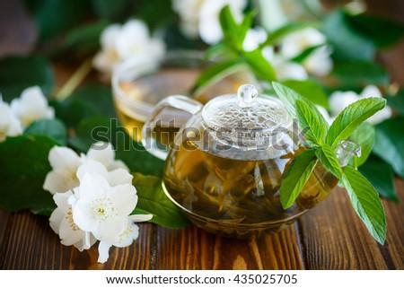 Jasmine tea in a glass pot - stock photo
