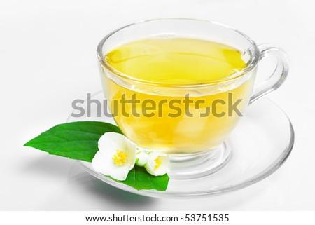 jasmine tea with jasmine flowers on white background (without isolation) - stock photo