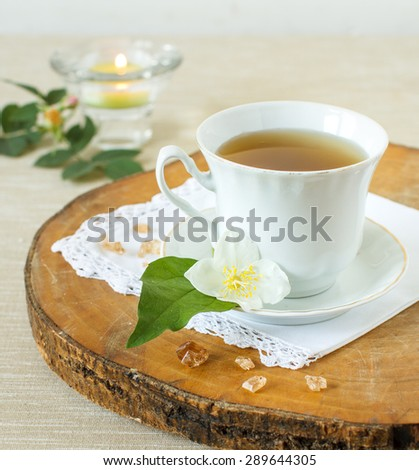 Jasmine tea with jasmine herb flower on wooden table - stock photo