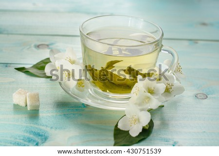 Jasmine tea with jasmine herb flower on wooden table background.  - stock photo