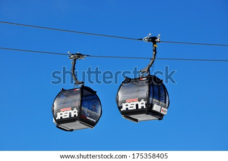 JASNA, SLOVAKIA - JAN 6: Modern cableway FUNITEL in ski resort Jasna - Low Tatras mountains on January 6, 2014 in Jasna - stock photo