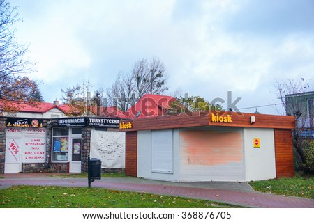 JASTRZEBIA GORA, POLAND - NOVEMBER 12, 2015: Closed kiosk and stores at the town center on a cloudy day  - stock photo