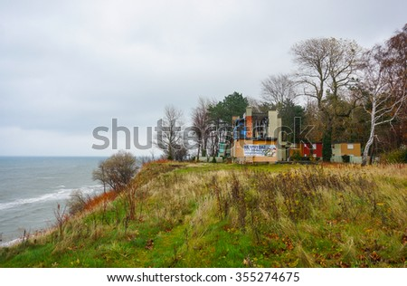 JASTRZEBIA GORA, POLAND - NOVEMBER 12, 2015: Damaged building close by the coast on a cloudy day