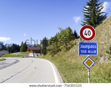 Jaunpass, Switzerland - October 03, 2016: Panorama of the landscape road pass eparating the Swiss-German zone from the Swiss-French zone