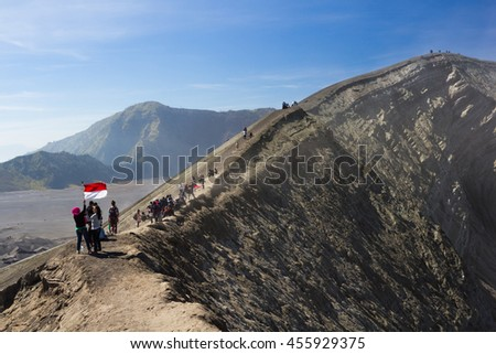 Java, Indonesia - August 16, 2015: Many tourists Travel to Mount Bromo, Mount Bromo is an active volcano and part of the Tengger massif, in East Java, Indonesia. At 2,329 metres. - stock photo