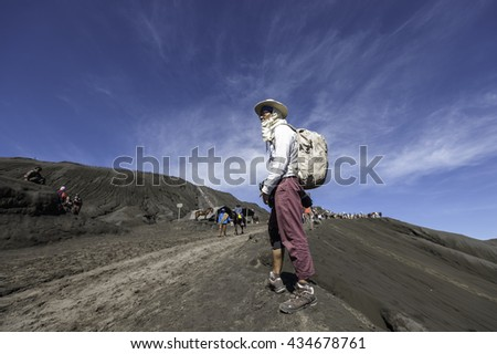 Java, Indonesia -JUNE 4, 2016: Tourists Travel to Mount Bromo, Mount Bromo is an active volcano and part of the Tengger massif, in East Java, Indonesia. At 2,329 metres. - stock photo