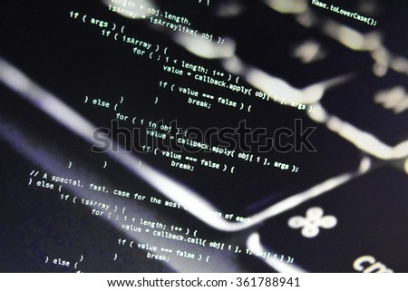 Javascript code image on computer screen with laptop keyboard background. Web development and programming with CSS, JavaScript and HTML. Information technology website coding standards for web design - stock photo