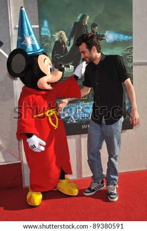 "Jay Baruchel & Mickey Mouse at a benefit screening for his new movie ""The Sorcerer's Apprentice"" at Walt Disney Studios. July 12, 2010  Burbank, CA Picture: Paul Smith / Featureflash - stock photo"