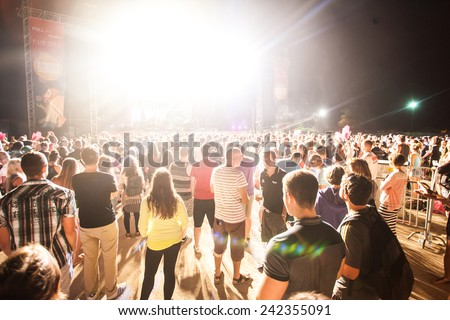 JAZ, MONTENEGRO - JULY 16: Audience infront of the Main Stage at SEA DANCE Music Festival - EXIT ADVENTURE, during EYESBURN performance, on July 16, 2014  at the Jaz beach near Budva, Montenegro. - stock photo