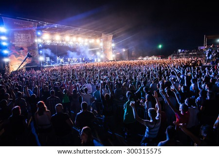 JAZ, MONTENEGRO - JULY 16 2015: Audience infront of the Main Stage during Dubioza Kolektiv's performance at SEA DANCE Music Festival, on July 16, 2015 at the Jaz beach near Budva, Montenegro.
