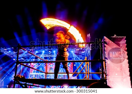 JAZ, MONTENEGRO - JULY 17 2015: Performer with flames infront of the Dance Paradise stage at SEA DANCE Music Festival - EXIT ADVENTURE, on July 17, 2015 at the Jaz beach near Budva, Montenegro. - stock photo