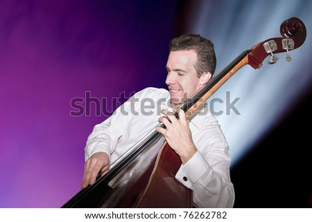 Jazz bassist playing at the National Arts Centre. - stock photo