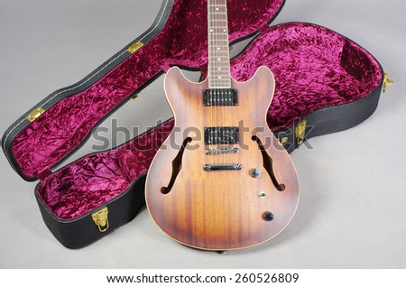 Jazz guitar and case - stock photo