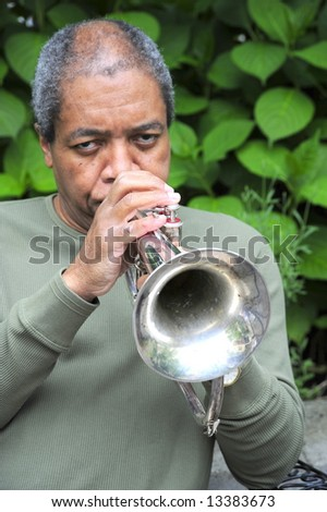 Jazz musician performing outdoors. - stock photo